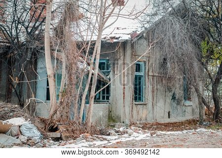 Abandoned And Derelict Building Surrounded By Trees In A Deserted Land In Eskisehir, Turkey. Buildin