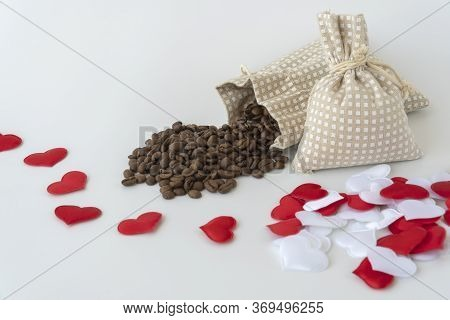 Coffee Beans Are Spilled Out Of The Bag. Decorated With Decorative Hearts. Romantic Theme, Making Co