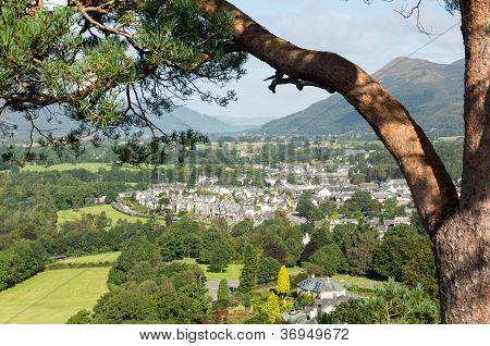 Framed by pine branch view over town of keswick in English Lake District poster