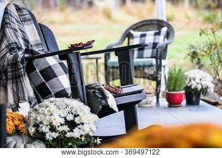 Adirondack Rocking Chair With Traditional Style Buffalo Check Blanket And Pillows On A Porch Or Pati