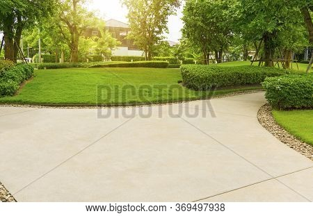 Gray Curve Pattern Walkway, Sand Washed Finishing On Concrete Paving, Brown Gravel On Border, A Smoo
