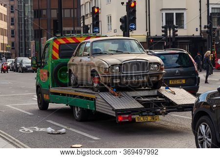London, Uk: Dec 2, 2017: A Motor Car Transporter Is Seen In Central London, Carrying A 1979 Vanden P