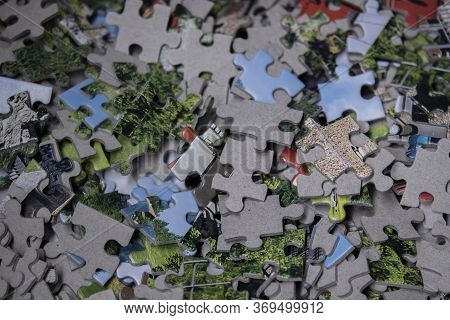 Multicoloured Puzzles On A White Background. Isolated. Top View