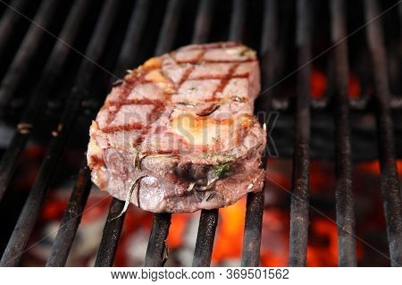 Preparation Of Steak On The Grate And Coals. Chef Making Steak. Beef Tender Steak On The Grill.