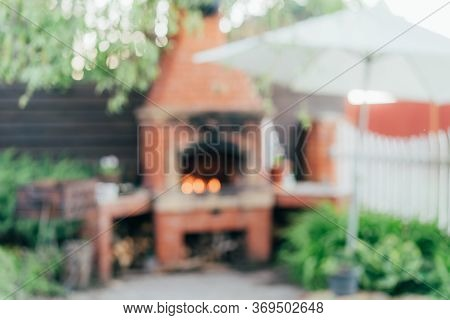 Defocused Outdoor Scene With Back Light Representing Outdoor Cooking, Summer Gathering, Bbq, Grill I