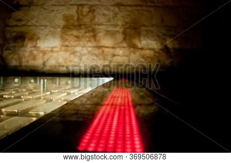 Many Gold Bars Kept In The Dark Of A Safe Strong Room With Red Led Light Bar