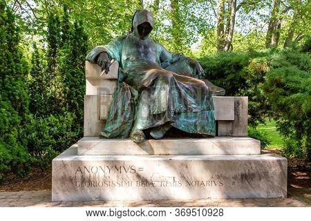 Budapest, Hungary - May, 2017: Statue Of Anonymous In Varosliget Park Near Vajdahunyad Castle. Sunny
