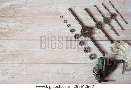 Vintage Equipment For Manual External Thread Cutting. Locksmith Vises, Dies Of Different Diameters A