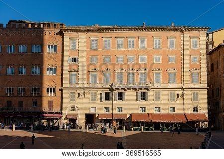 Siena, Tuscany, Italy - Jan 5, 2017: Ancient Palaces (palazzo Sansedoni And Chigi Zondadari) In Piaz