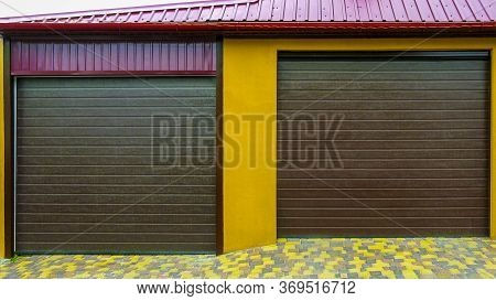 Brick Garage With Roller Shutters For Two Cars In A Residential District. Garage Doors. Garage. New