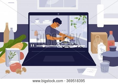 Laptop On Kitchen Table With Cooking Online Master Class. Culinary Video Blog, Show With Man Prepari