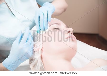 A Female Beautician Makes An Injection To A Female Client In A Cosmetics Office. Cosmetic Procedures