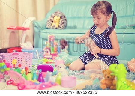 Child Little Girl Play Toys Disorderly Mess In Living Room A Dirty Or Untidy State Of Toy And Doll A
