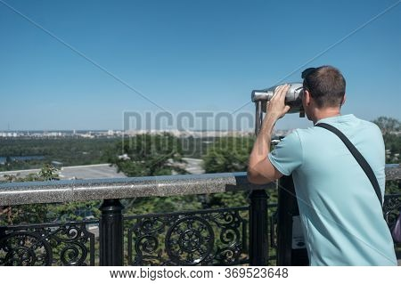 Young Tourist Looking At Sightseeing Observation Binocular