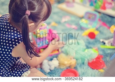 Close Up Child Little Girl Play Toys Disorderly Mess In Living Room A Dirty Or Untidy State Of Toy A