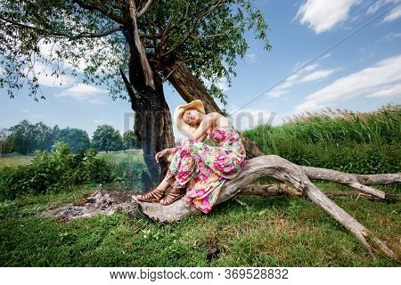 Woman sitting on a tree