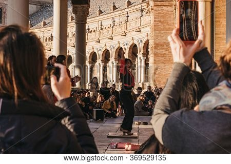 Seville, Spain - January 17, 2020: Flamenco Dancer Performs In Front Of The Crowd In Plaza De Espana