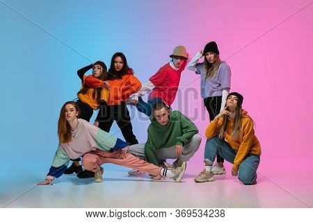 Group Of Dancers, Boys And Girls Dancing Hip-hop In Stylish Clothes On Colorful Gradient Background