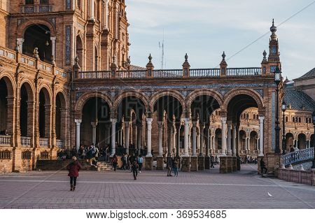 Seville, Spain - January 17, 2020: People Amongst Arches On Plaza De Espana, A Plaza In The Parque D