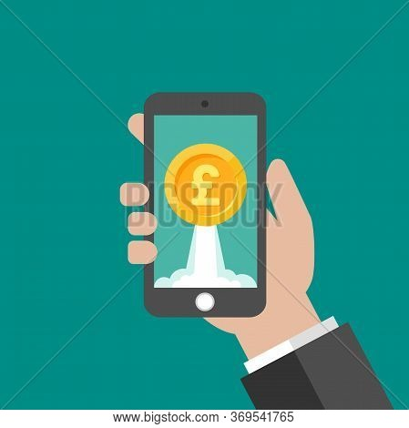 Hand Holding Smartphone With Gold Pound Sterling Coin As Rocket On The Screen. Income Growth.