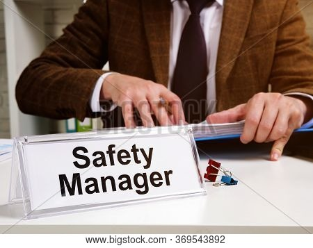 Safety Manager Works With Instructions Of Osha Occupational Safety And Health Administration.