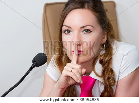 Business Theme:  Portrait Of Successful  Woman Manager With Speakerphone In An Office Environment.