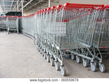 Empty Shopping Trolley Cart In Supermarket Cause Shopping Online And E-commurce Is New Normal Of Cus