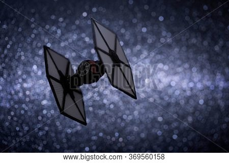 JUNE 1 2020:  First Order Tie Fighter from Star Wars The Force Awakens, flying through a star field - Hasbro miniature ship