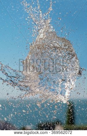 Exploded Water, Abstract Water Shape In The Air Over The Sea With Blue Sky Background. Selective Foc