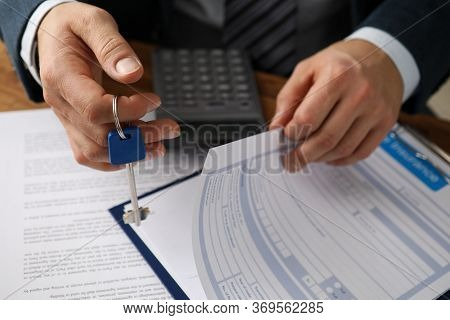 Man In Suit Prepares Document For Rental Property. Registration Home And Property Insurance Policy.