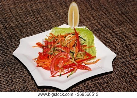 Served Pickled Salad With Carrot, Cucumber And Tomatoes On The White Plate
