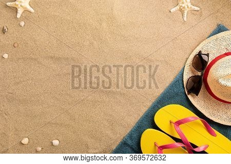 Beautiful Summer Holiday Beach Background With Some Accessories And Shells On Sand Background