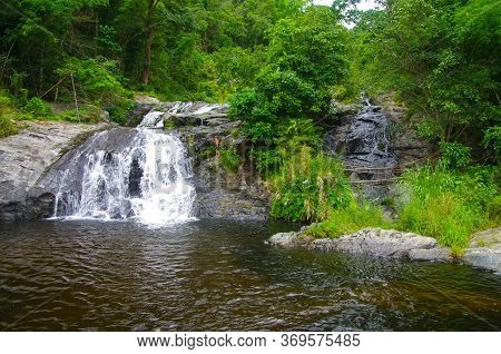 Khlong Lan, Thailand - August, 2016: Jungle Landscape With Flowing Water Of Khlong Nam Lai Waterfall