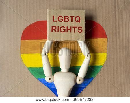 Lgbtq Rights Text Inscription On Protester Hands Of Wooden Person On Craft Paper Poster On Lgbtq Fla