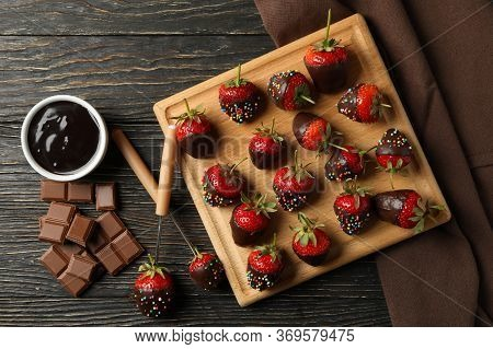 Chocolate Fondue. Strawberry In Chocolate On Wooden Background, Top View