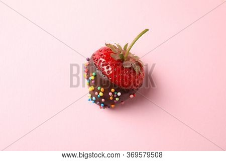Chocolate Fondue. Strawberry In Chocolate On Pink Background