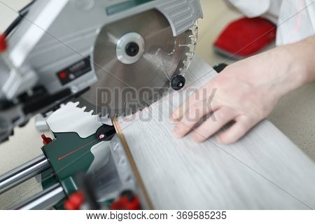 Man Uses Circular Saw Table While Cutting Laminate. Laminate Laying Technology With Click Lock. Feat