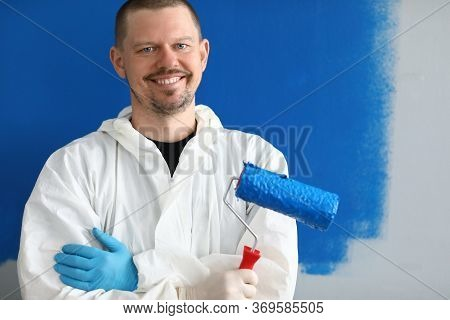 Male Painter In Uniform With Roller In His Hand. Limitations Person With An Allergy To Use Paint. Wa
