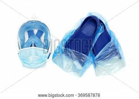 Full Face Snorkel Mask With A Disposable Surgical Face Mask On And Fins With Protective Shoe Covers