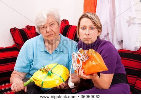 Old And Young Woman Getting Improper Gifts