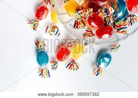 Bowl Full With Mix Hard Wrapped Candies Isolated On White Background.