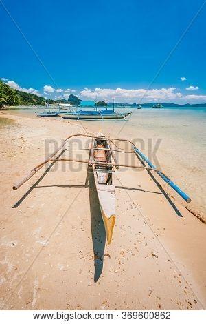 Philippines Beach Landscape - Banca Boat At Corong Corong Beach In El Nido, Palawan Island