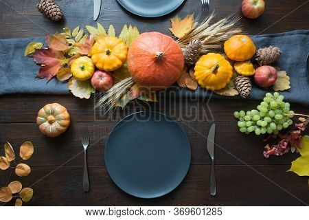 Fall Dark Place Setting With Leaves And Pumpkins. Centerpieces Thanksgiving Day. Party. View From Ab