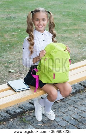 Study To Achieve. Happy Child Back To School. Small Girl Hold School Bag Sitting On Bench. Study And