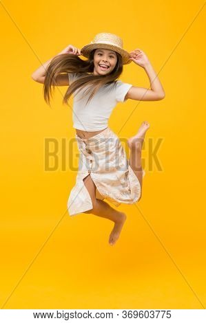 Happy Barefoot Child Jump. Carefree Childhood Happiness. Small Girl Wear Summer Outfit. Summer Vacat