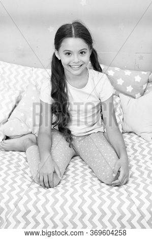 Relax And Ease Transition To Sleep. Little Girl Pajamas Ready For Bedtime. Relaxation Concept. Menta