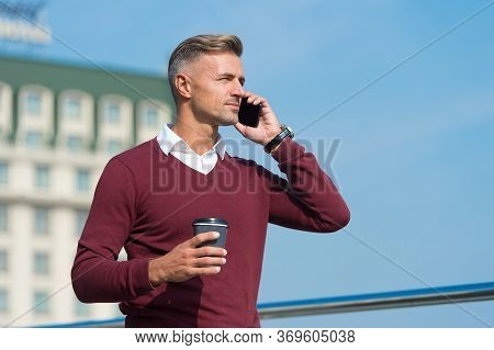 Hello. Handsome Man Talk On Phone Drinking Coffee Outdoors. Answering Phone Call. Direct Marketing B