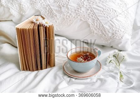 Openwork Lace, Cotton White Blanket. Book Botany, Mug With Natural Herbal Tea Made From Mint, Summer