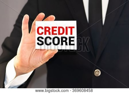 Man In Suit Showing A Signboard With The Different Ranges Of The Credit Score: Excellent, Good, Fair