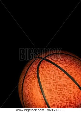 Basketball Isolated On A Black Background As A Sports And Fitness Symbol Of A Team Leisure Activity
